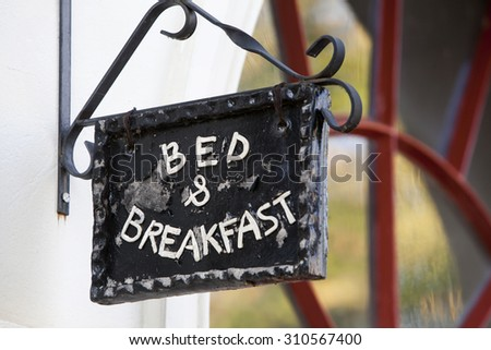 Metal Bed and Breakfast sign on building  - stock photo