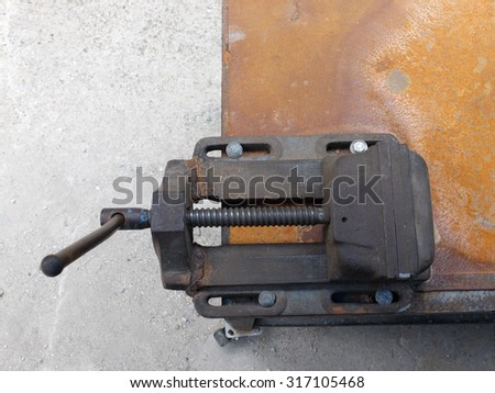 Metal bench vice - stock photo
