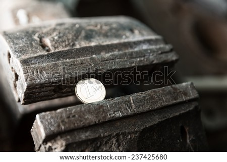 Metal bench vice with euro coin - stock photo