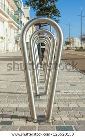 Metal bicycle rack on street in France - stock photo