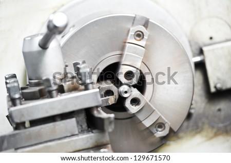 metal blank machining process on lathe with cutting tool - stock photo