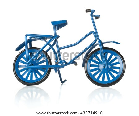 Metal blue miniature bicycle on white background - stock photo