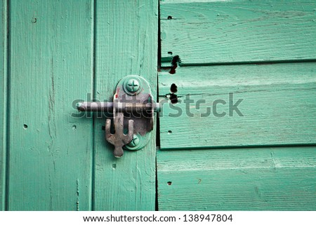 Metal bolt lock on a blue painted shed door - stock photo