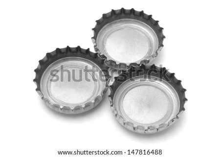 Metal Bottle Caps On White Background