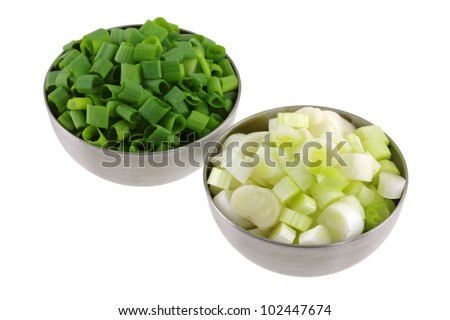 Metal bowls of Chopped Spring Onion separated into green leaves and white bulbs, isolated on white background - stock photo