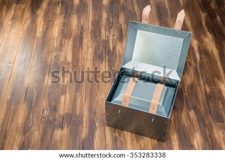 metal box in side of metal box on wooden table, Studio Shot - stock photo