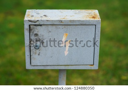 """Metal box with """"lightning"""", which warns of danger of electric shock. - stock photo"""