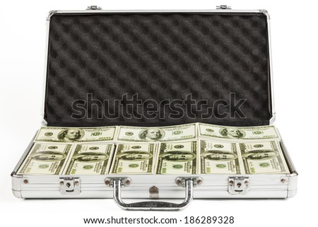 Metal Briefcase full with dollar banknotes isolated on white background