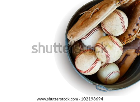 metal bucket of old baseballs and leather glove for practice, isolated on white with copy space - stock photo