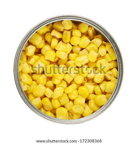 Metal can full of corn kernels isolated over white background, view above - stock photo