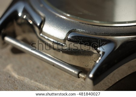 metal casing of a wristwatch in close-up