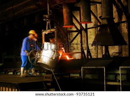 metal casting process with high temperature fire in metal part factory - stock photo
