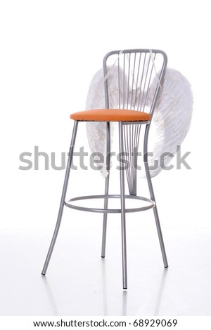 metal chair and white angel wings isolated on white