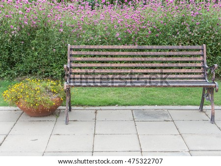 Metal chair in the beautiful garden