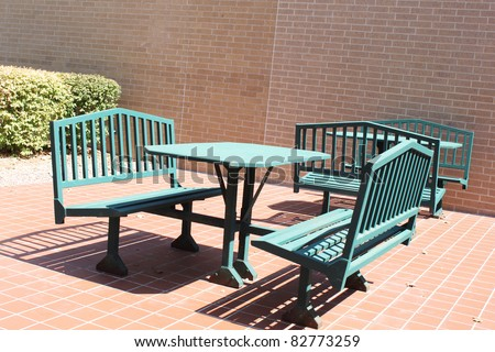 Metal chairs and table outside