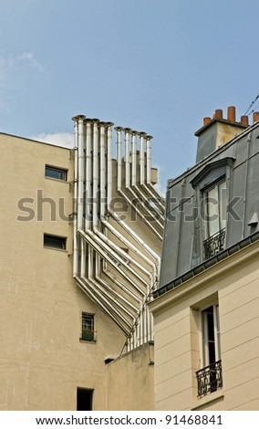 metal chimney on a building in town (Paris France) - stock photo