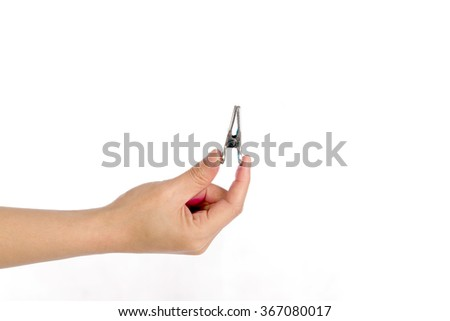 Metal clip with hand on white background, selective focus
