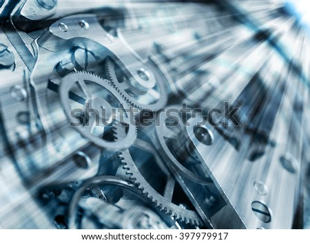 Metal Cogwheels in clock mechanism , abstract sun beams,  Concept  Movement is life, Teamwork , Idea Technology. Macro