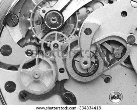 Metal Cogwheels inside Clockwork. Concept Eternity, Teamwork , Idea Technology. Black and white Macro Photo. - stock photo