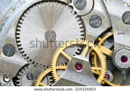 Metal cogwheels inside clockwork. Concept Eternity, Teamwork , Idea Technology. Macro.