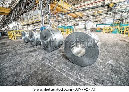 Metal coils in industrial warehouse. - stock photo