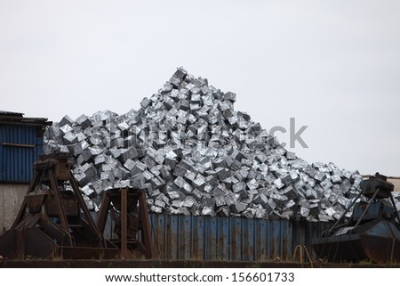 Metal container at a dump yard filled with a pile of sorted recyclable waste