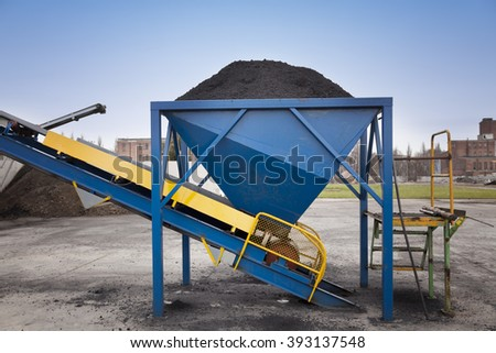 Metal container with coal at the power plant with conveyor belt  - stock photo