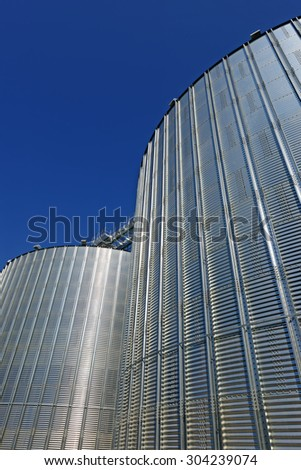 Metal containers for storage of a grain elevator - stock photo