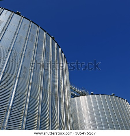 Metal containers for storage of a grain elevator