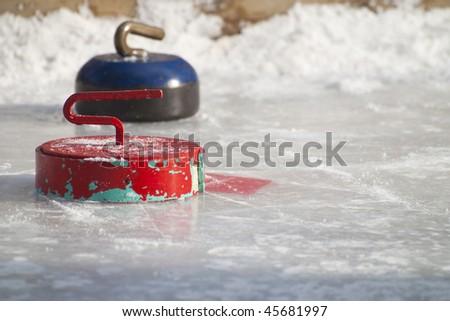 Metal curling stones - stock photo