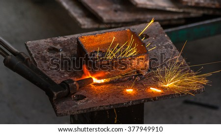 Metal cutter, steel cutting with acetylene torch, industrial worker on working area - stock photo