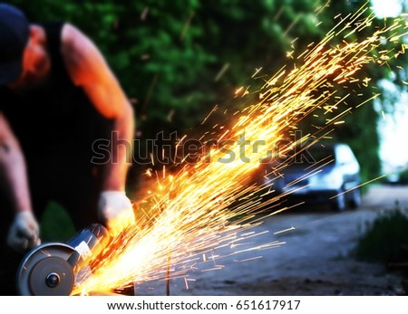 Metal cutting. Metal cutting with angle grinder.Man cuts metal
