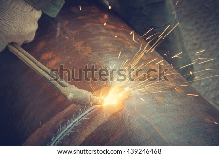 Metal cutting with acetylene torch. - stock photo