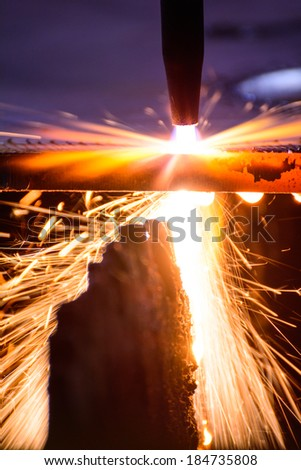 metal cutting with acetylene torch  close-up on low ligth - stock photo