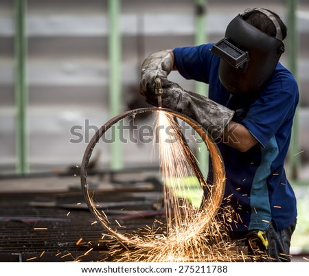 metal cutting with acetylene torch (Focus on Torch) - stock photo