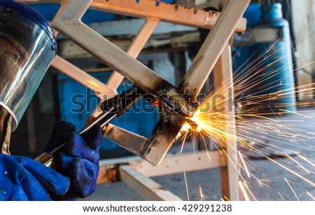 metal cutting with acetylene torch in factory - stock photo