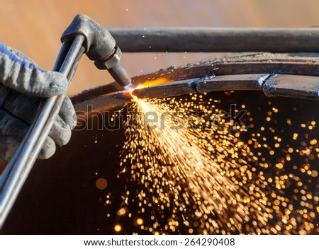 Metal cutting with an acetylene torch - stock photo