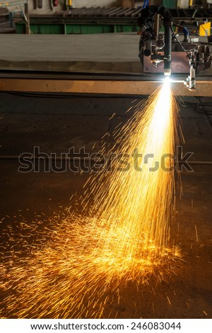 metal cutting with plasma torch close-up on low ligth