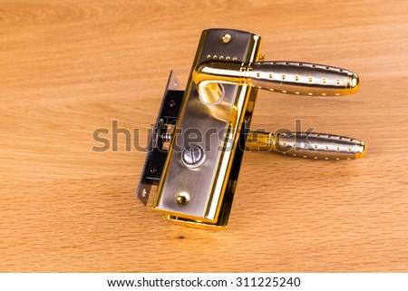 Metal door handles. Beautiful metal sparkles of light. Modern door mechanisms. - stock photo
