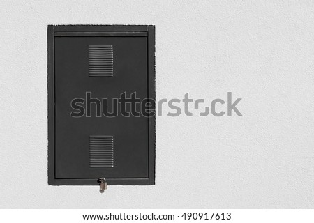 Metal door in the wall of the house for energy.