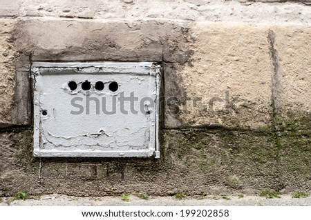 Metal door to an old air system - stock photo