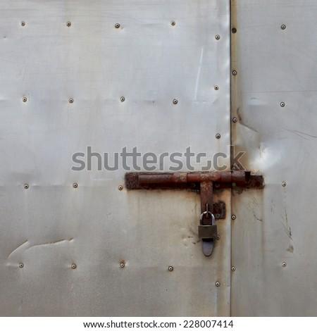 Metal door with lock - stock photo