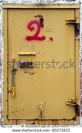 Metal door with sprayed number in red - stock photo
