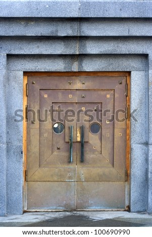 Metal doors in the granite wall - stock photo