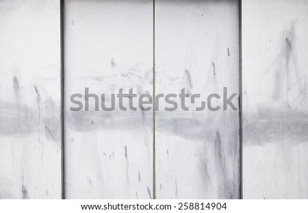 Metal doors of an elevator door detail dirty and stained - stock photo