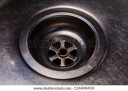 Metal drain in the sink with scratches - stock photo