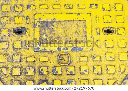 Metal drain lid on ground street - stock photo