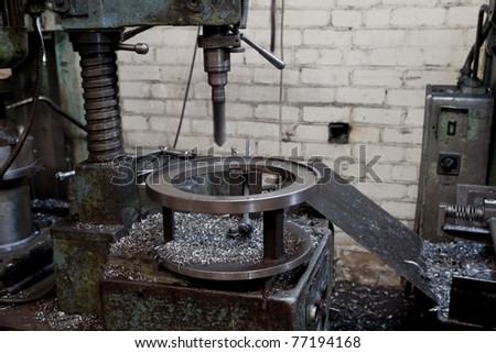 Metal drill - drilling process. Metal industrial machines and tools