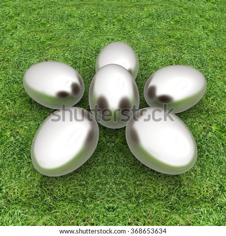 Metal Easter eggs as a flower on a green grass
