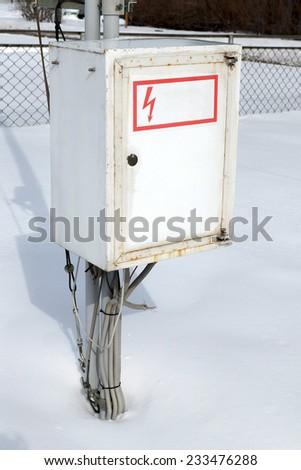 Metal electric box in the winter. - stock photo